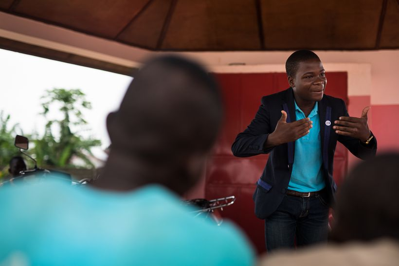 Romaric Ouitona, president of Youth Ambassadors in Benin, speaks to his peers at a youth center that offers family planning s