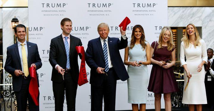 Donald Trump Jr., Eric Trump, Donald Trump, Melania Trump, Tiffany Trump and Ivanka Trump attend an official ribbon-cutting c