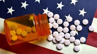 Prescription Pills spilled on USA flag