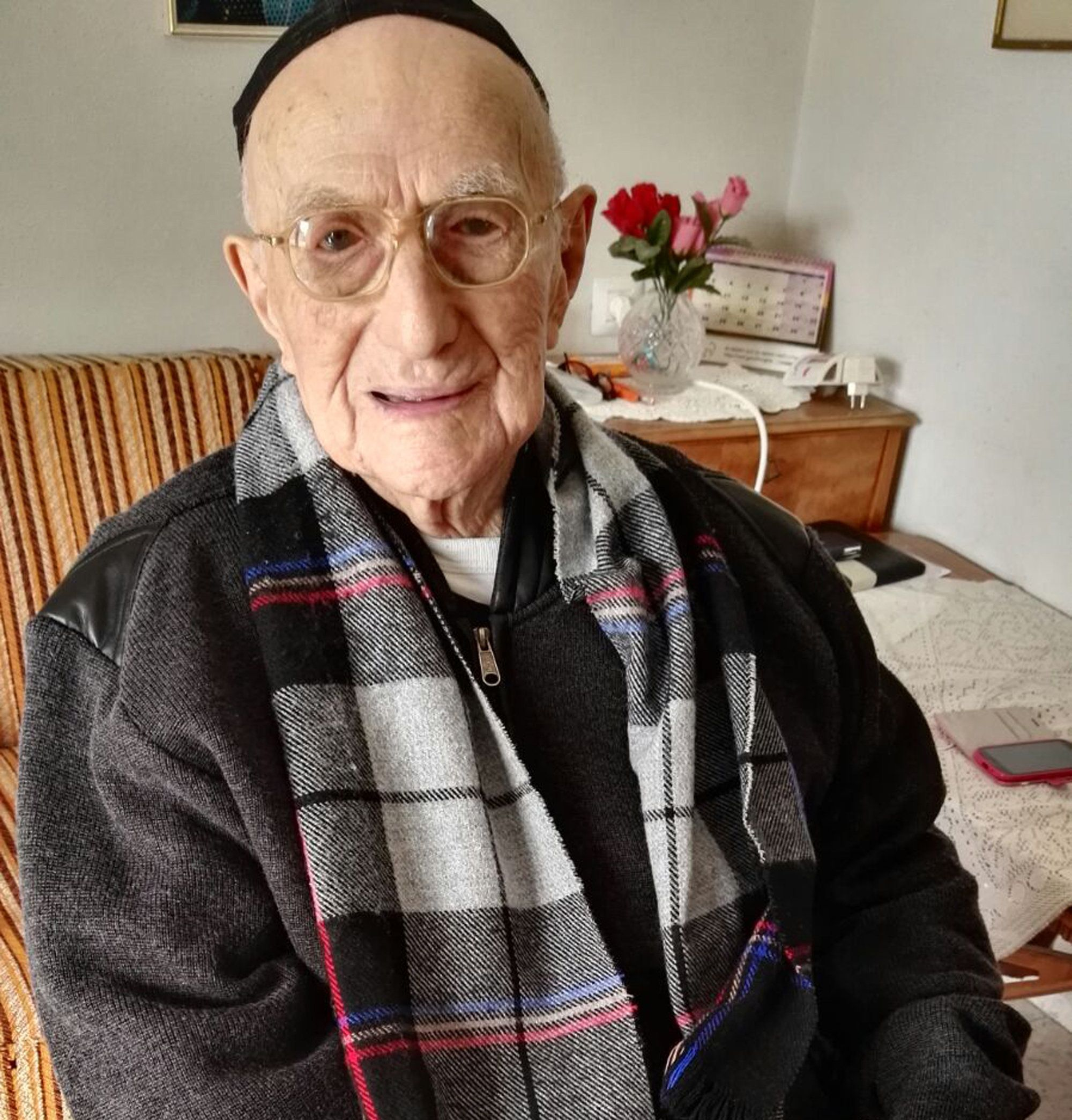 A picture taken on January 21, 2016, shows Yisrael Kristal sitting in his home in the Israeli city of Haifa. Yisrael, an Israeli Holocaust survivor, may be the world's oldest man at 112, Guinness World Records said, providing he can find the documents to prove it. His family say he was born in Poland on September 15, 1903, three months before the Wright brothers took the first aeroplane flight.  / AFP / SHULA KOPERSHTOUK        (Photo credit should read SHULA KOPERSHTOUK/AFP/Getty Images)