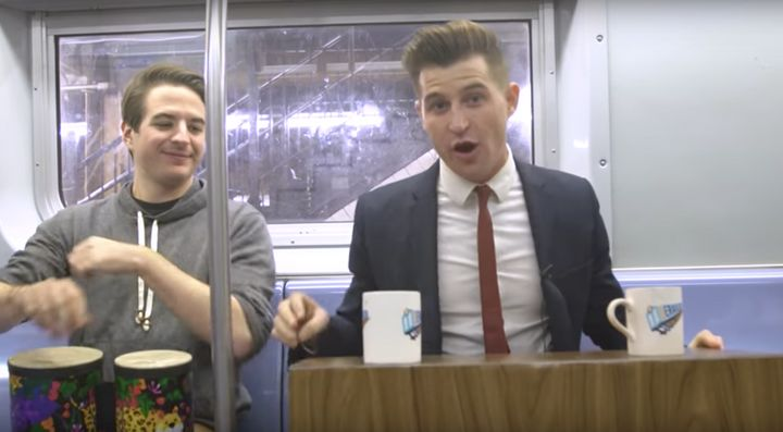 "Dean Dimitruk (right) hosts ""Derailed,"" a late night talk show filmed on a New York City subway train. Jeremy Christian (left"