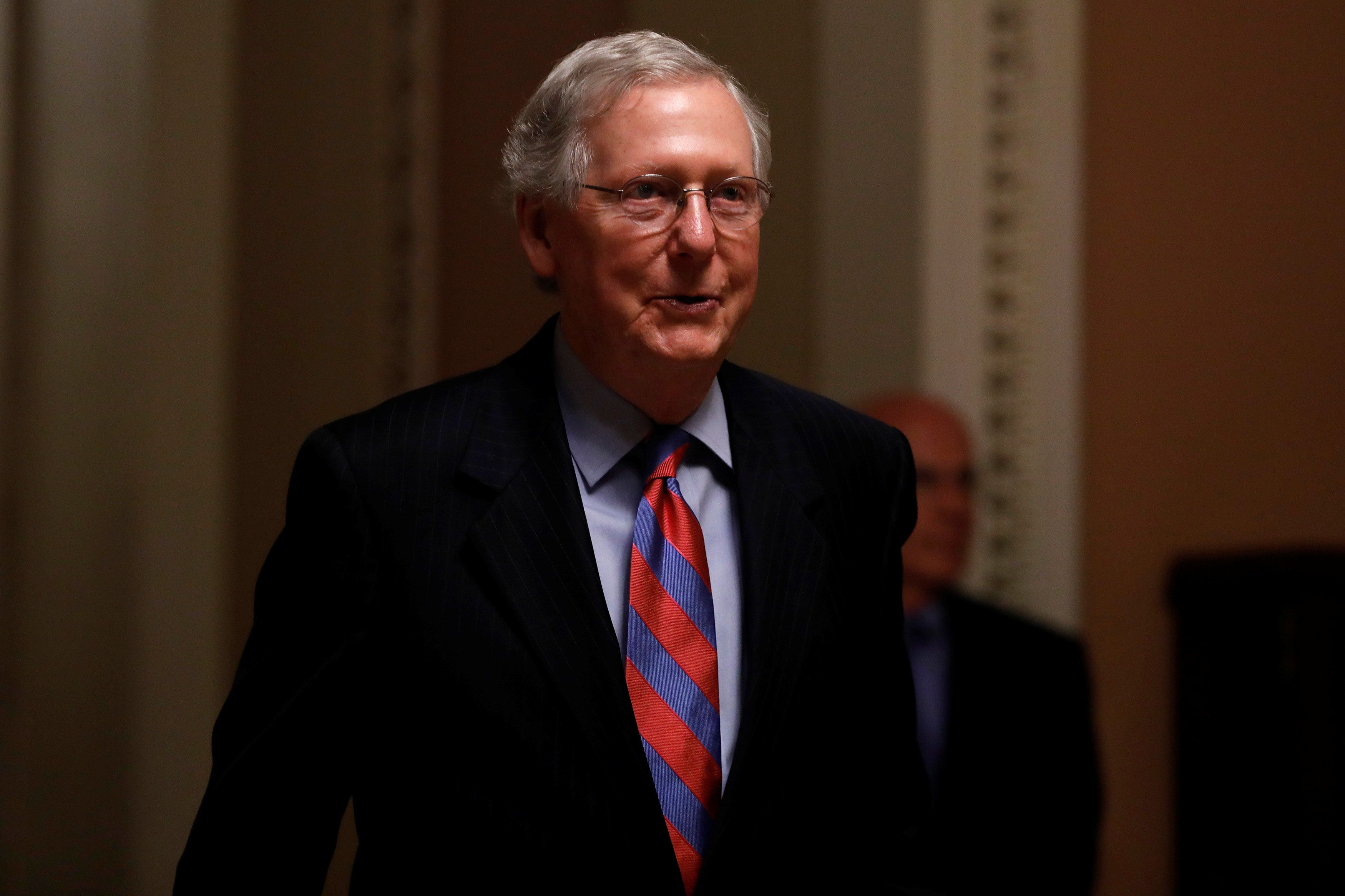 Senate Majority Leader Mitch McConnell walks to his office prior to an all night round of health care votes on Capitol Hill in Washington, U.S., July 27, 2017. REUTERS/Aaron P. Bernstein
