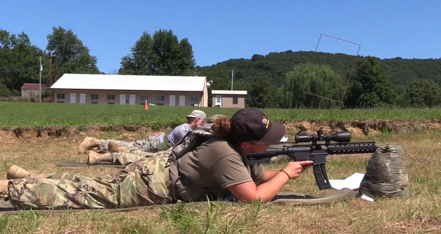 Children aim at targets during exercises at Military Adventure Camp in Flemingsburg,