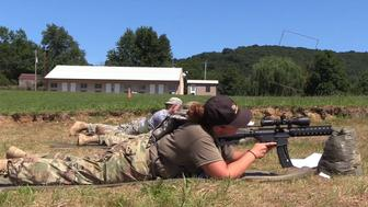 Campers at Military Adventure Camp in Flemingsburg Kentucky aim at targets
