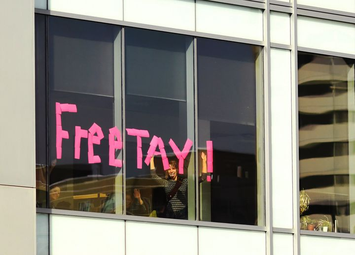 People wrote 'Free Tay!' with sticky notes in an office window across the street from the Alfred A. Arraj Courthouse on Augus