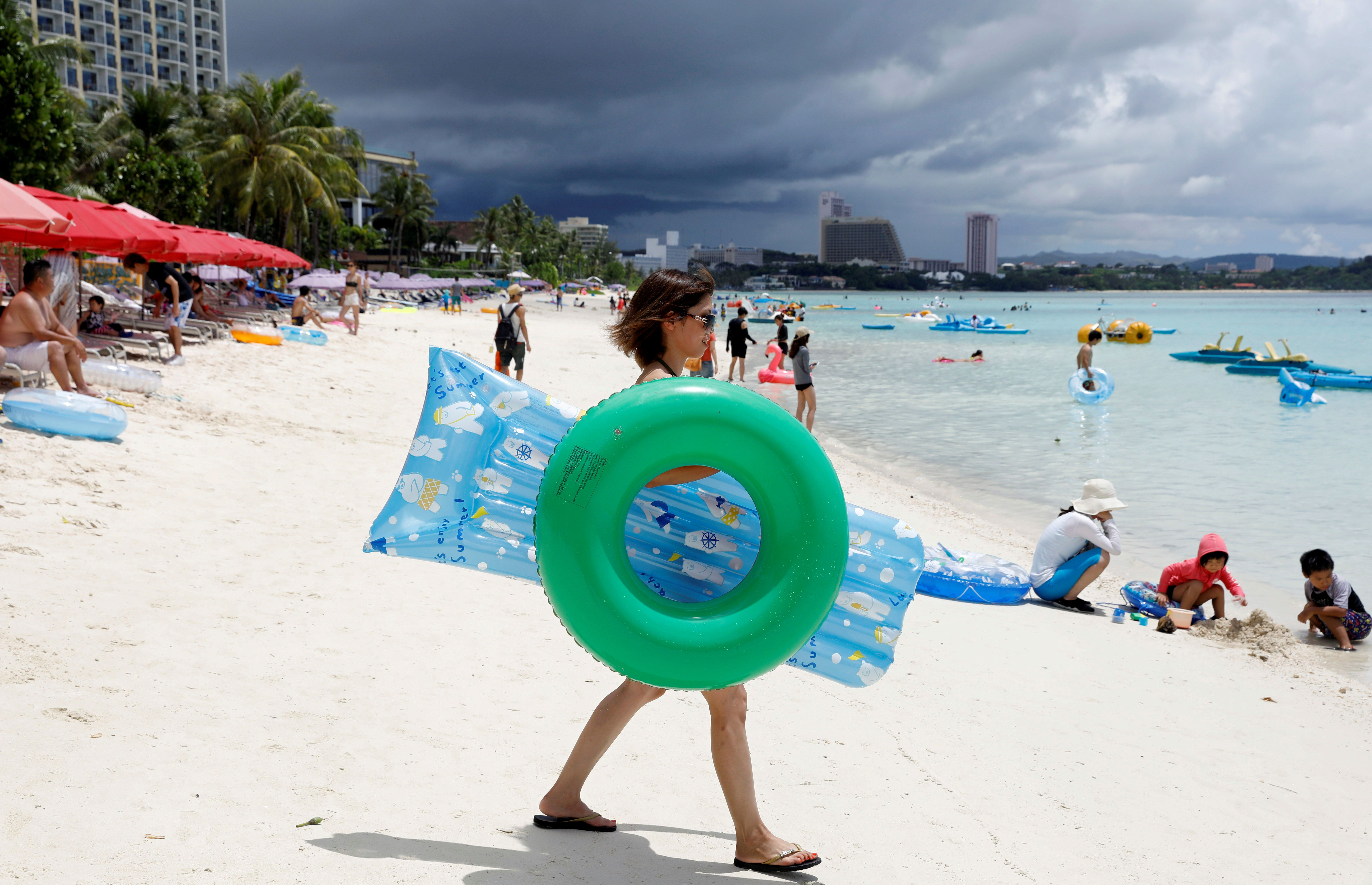 Tourists relax along Tumon