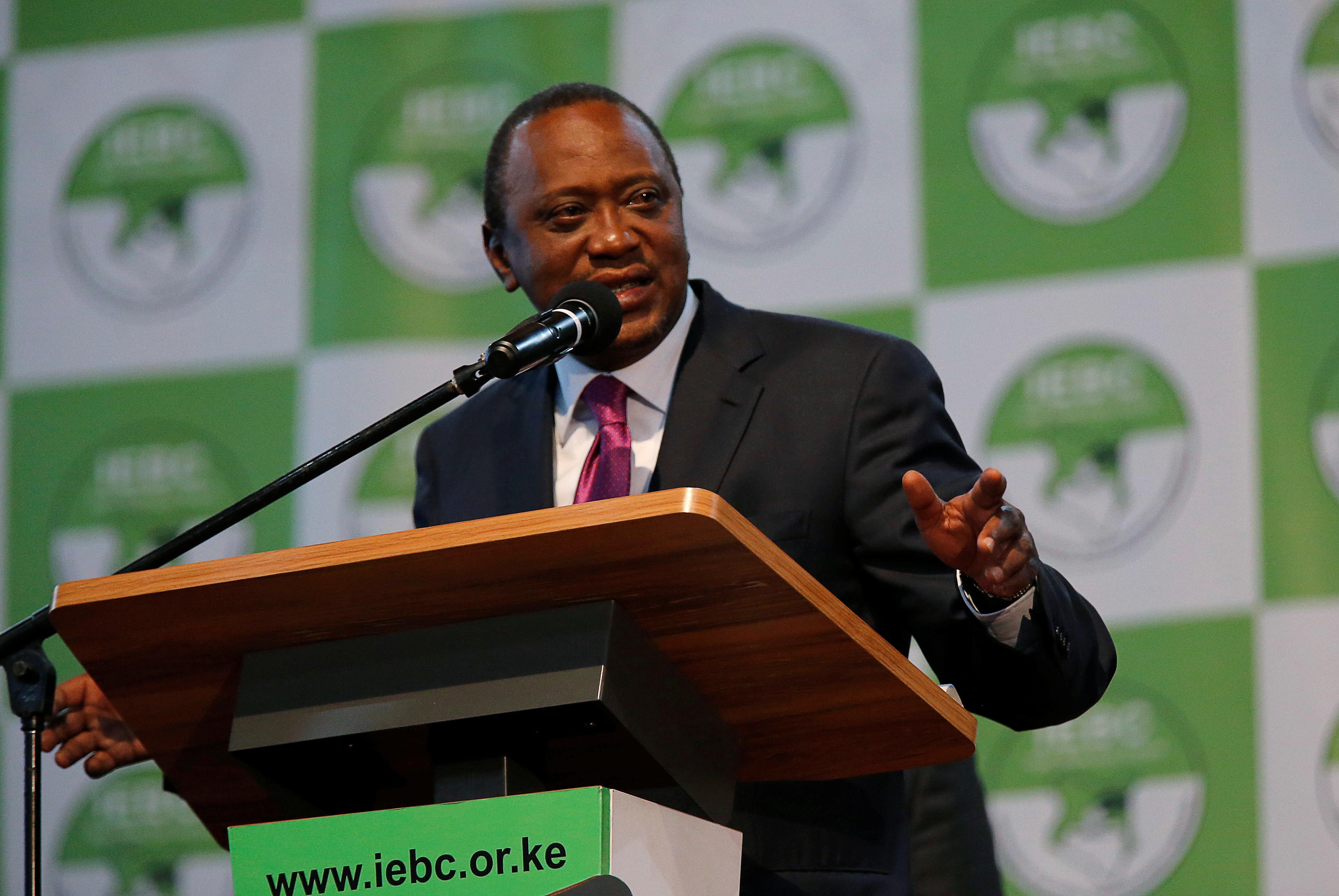 Incumbent President Uhuru Kenyatta speaks after he was announced winner of the presidential election at the IEBC National Tallying centre at the Bomas of Kenya, in Nairobi, Kenya August 11, 2017. REUTERS/Thomas Mukoya