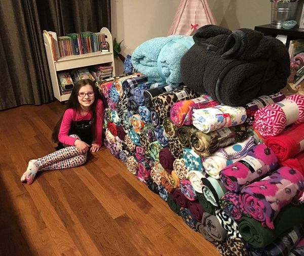 A few years ago, Emma Burkhart received two of the same blankets as gifts and it sparked an idea: Give blankets to children w