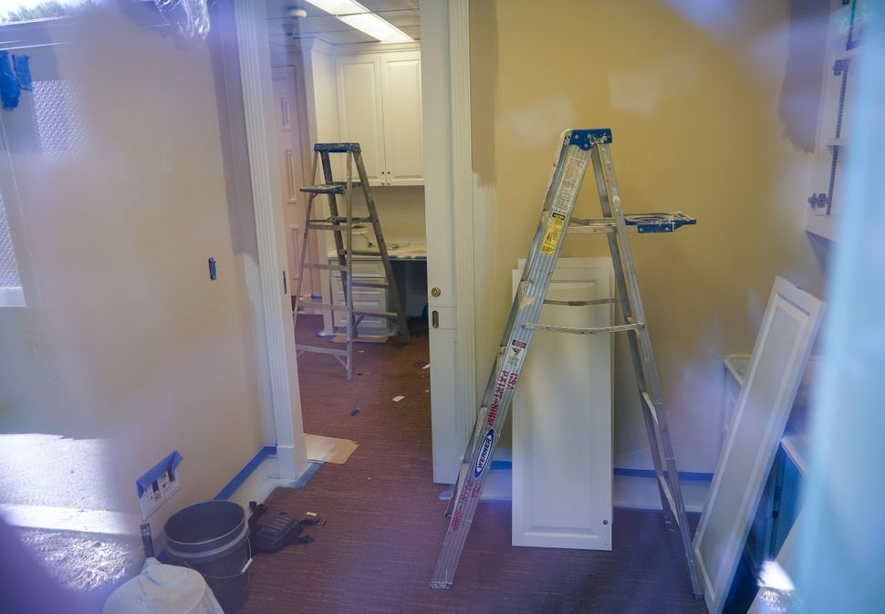 Ladders are seen inside of a press office in the West Wing.