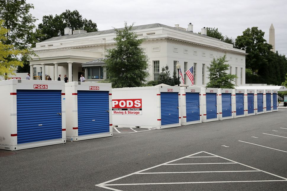 Furniture and materials from the White House are stored in temporary containers outside the West Wing.