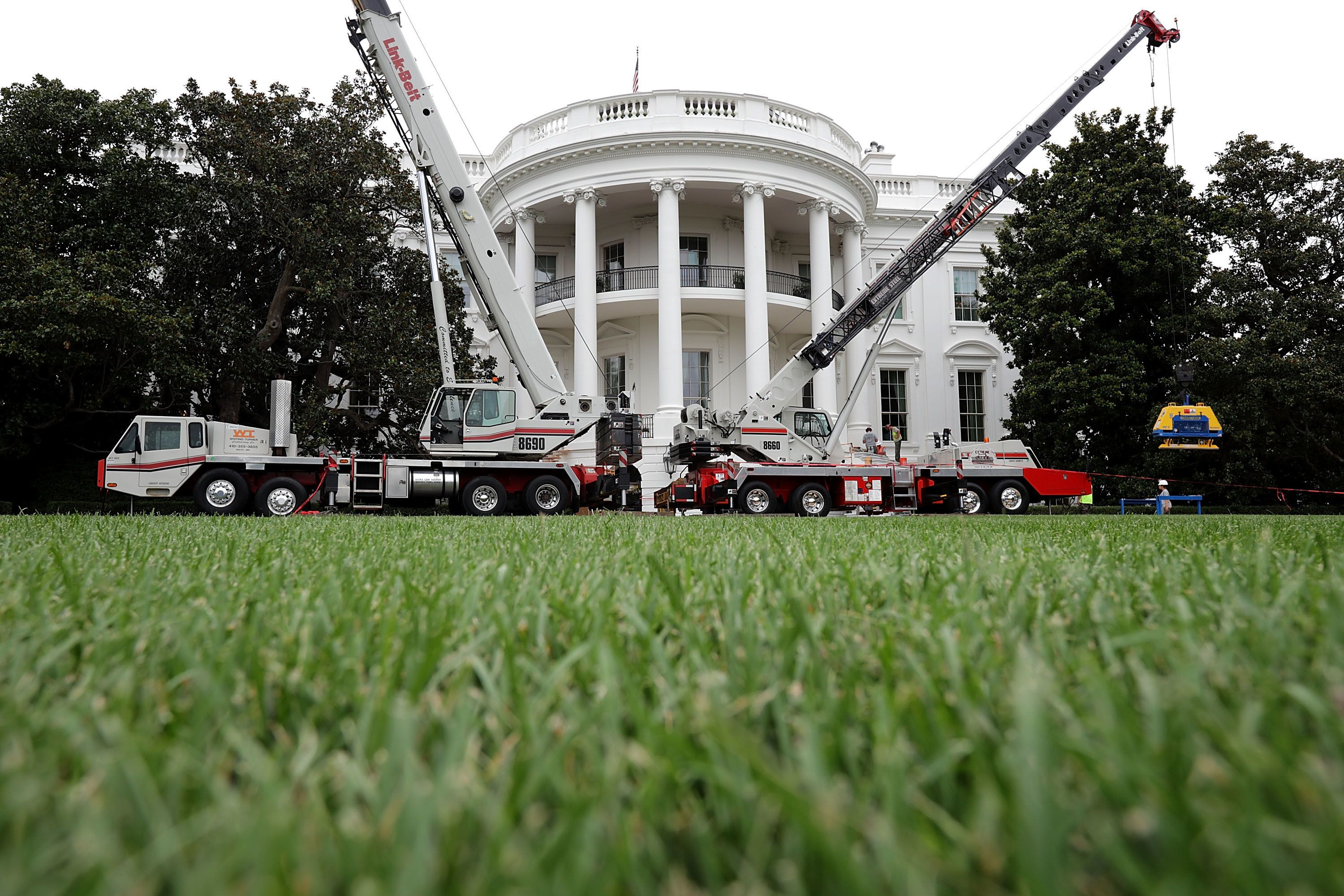 Chip Somodevilla via Getty Images Construction cranes work to repair the South Portico steps
