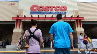A couple make their way toward the entrance of a Costco store in Alhambra, California on June 2, 2013. Costco stores have been linked to a multi-state outbreak of hepatitis A infections with at least 30 cases nationwide may be linked to an organic antioxidant blend of frozen berries from Townsend Farms, with seven confirmed illnesses in California. The product has been removed from the shelves of Costco stores and customers who bought the product are being notified. AFP PHOTO/Federic J. BROWN        (Photo credit should read FREDERIC J. BROWN/AFP/Getty Images)