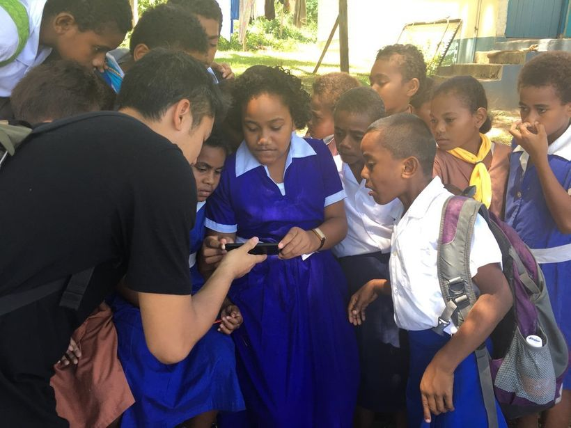 Producer Tash Tan of S1T2 sharing an AR demo to students as part of a LAUNCH Legends research trip to Fiji.