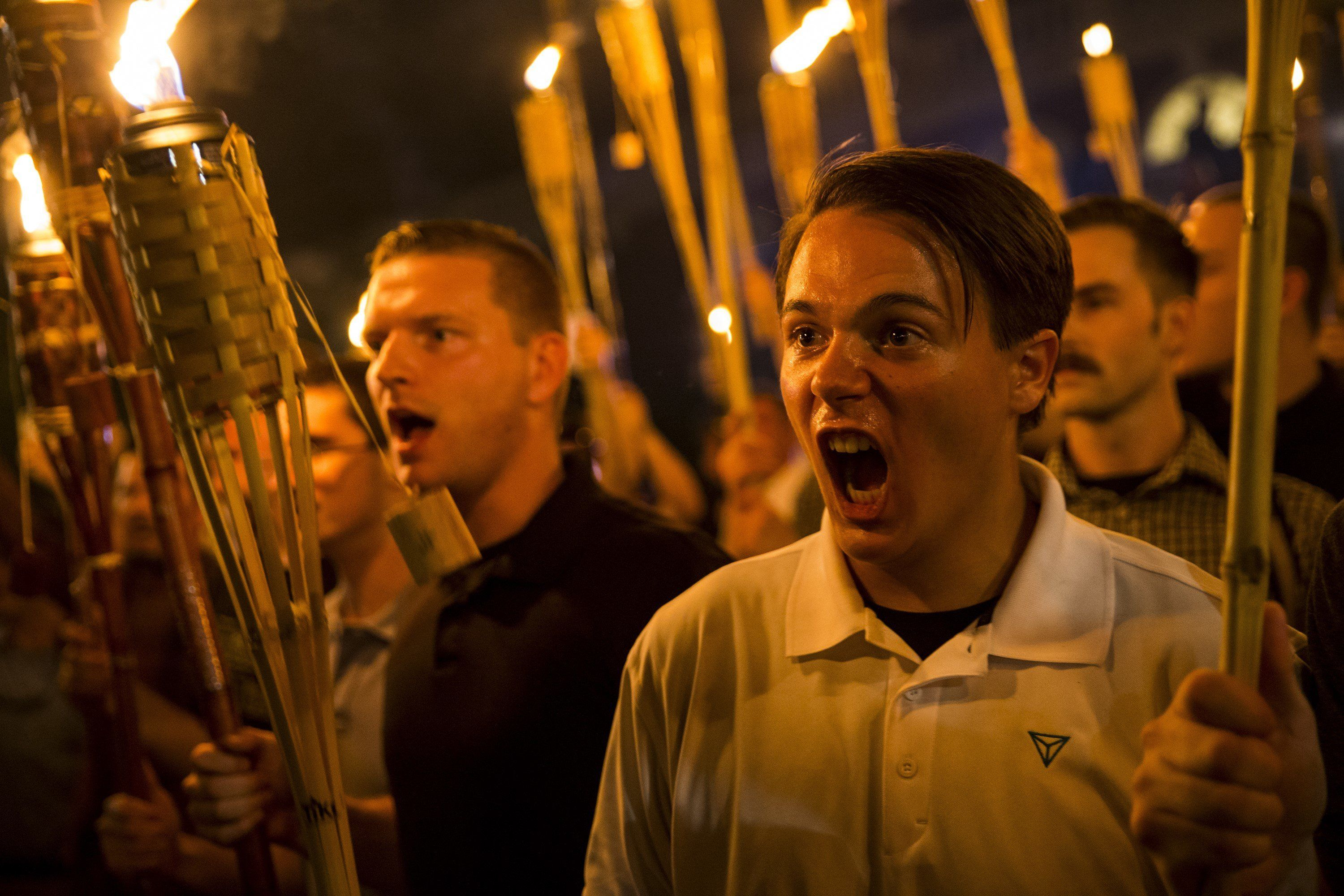 Chilling Scenes As Torch-Bearing Right-Wing Protestors March Through US