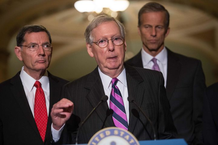 Senate Majority Leader Mitch McConnell (center) made audacious, frequently dishonest promises about what repeal would do