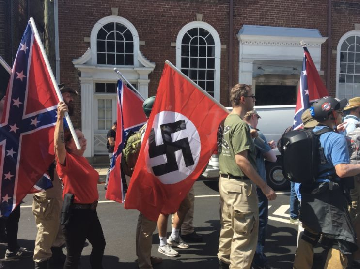 Nazi and Confederate flags at racist rally in Charlotteville. Photo Andy Campbell / HuffPost