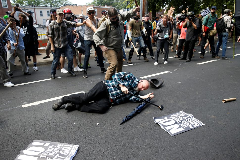 A man is down during a clash between white nationalist protesters and a group of counter-protesters.