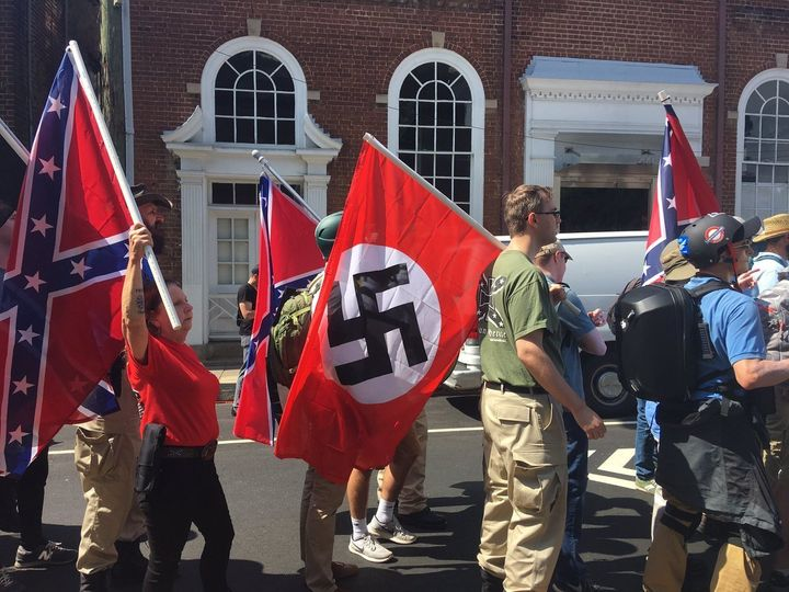 "Nazi and Confederate flags are carried at the ""Unite the Right"" protest in Charlottesville, Virginia."