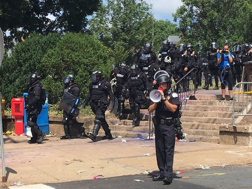 Police arrive at the scene of protests after a state of emergency is announced in Charlottesville, Virginia.