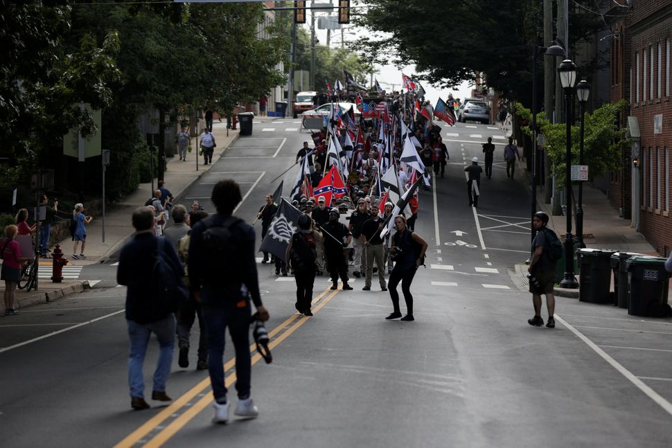 White nationalists march through the street.