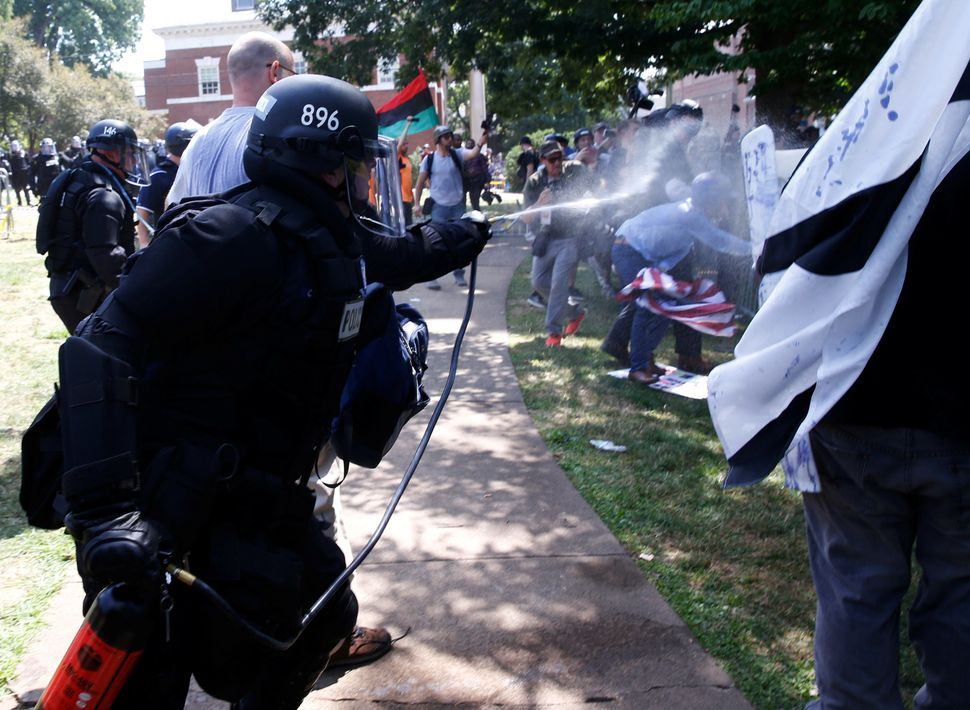 Virginia State Police use pepper spray as they move in during a clash between white nationalist protesters and coun