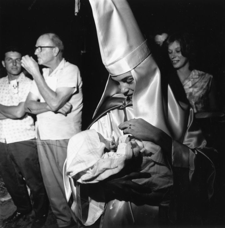 A woman member of the KKK takes her baby to a Klan meeting in South Carolina in 1965.