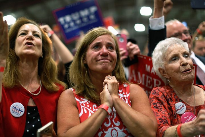 Three women attend a Donald Trump rally in Newtown, Pennsylvania, in October 2016.
