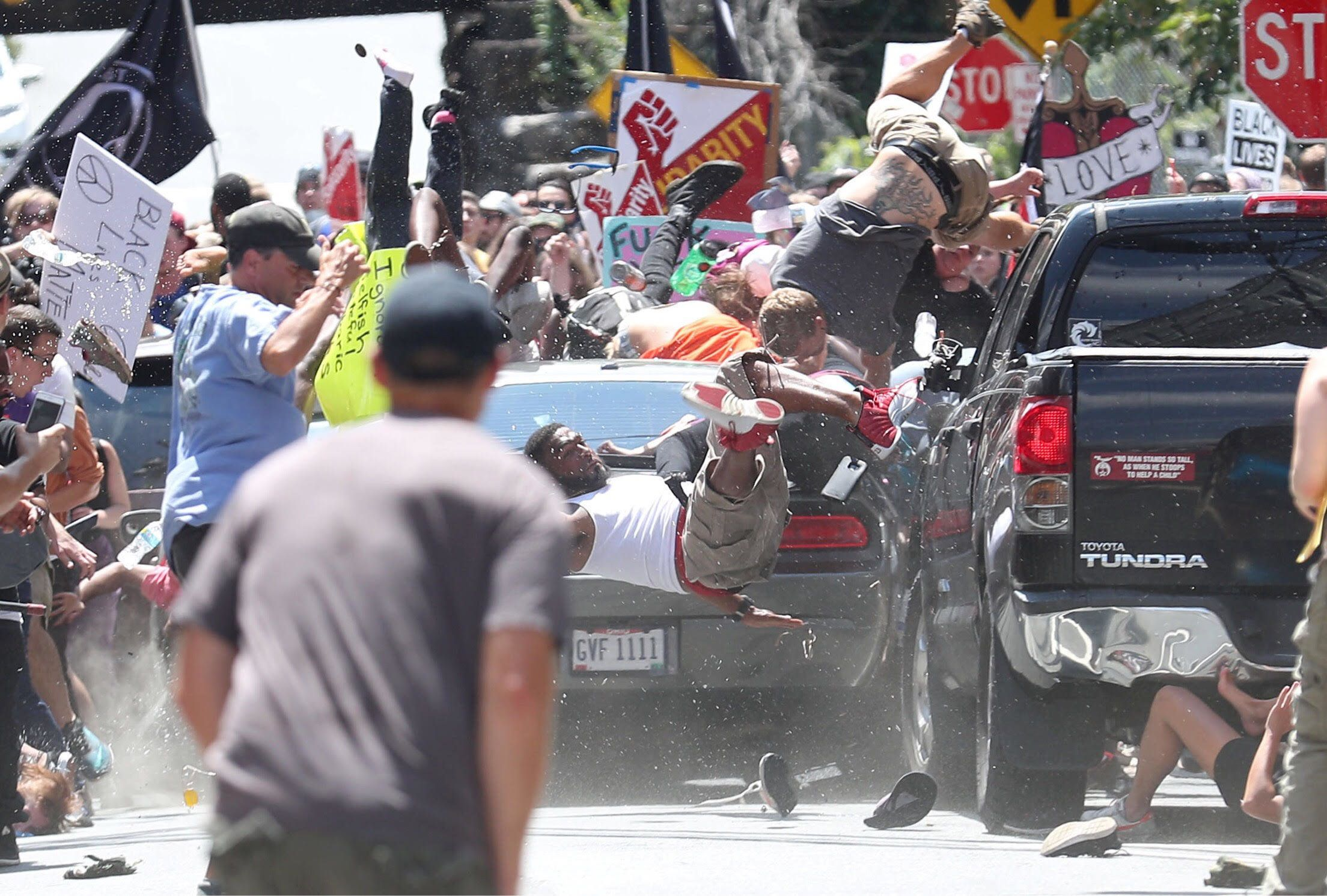 Crowd Rushes to Help After Car Crashes into Protesters in Charlottesville
