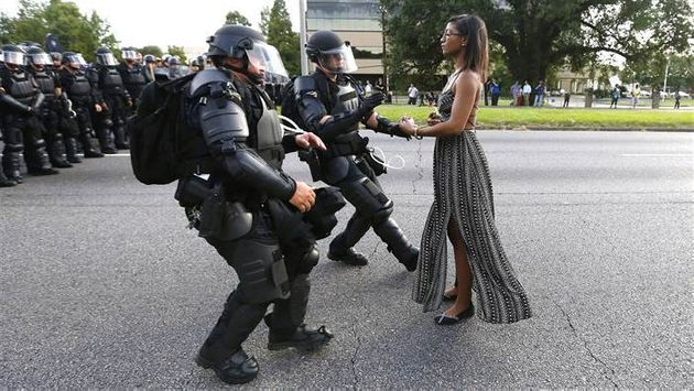 Black Lives Matter activist, Ieshia Evans, remaining calm while walking up to a line of riot police Baton...