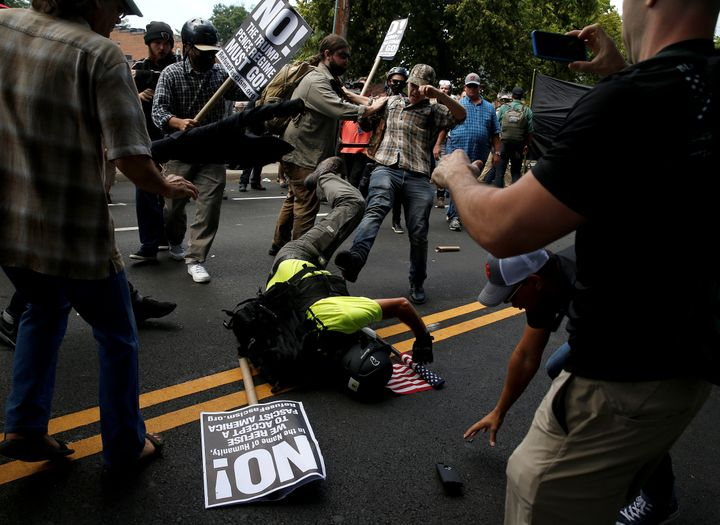 A white supremacist fights with counter-protesters in Charlottesville, Virginia, on Saturday.
