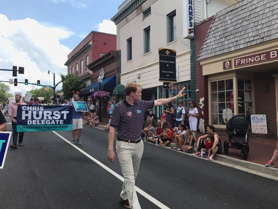 Chris Hurst, Democratic candidate for Virginia's House of Delegates, waves to the crowd at the Independence Day parade in Bla