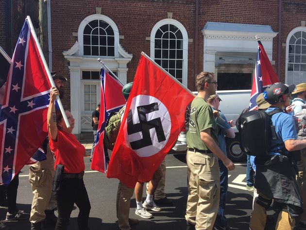 Demonstrators hold Confederate and Nazi flags in Charlottesville,