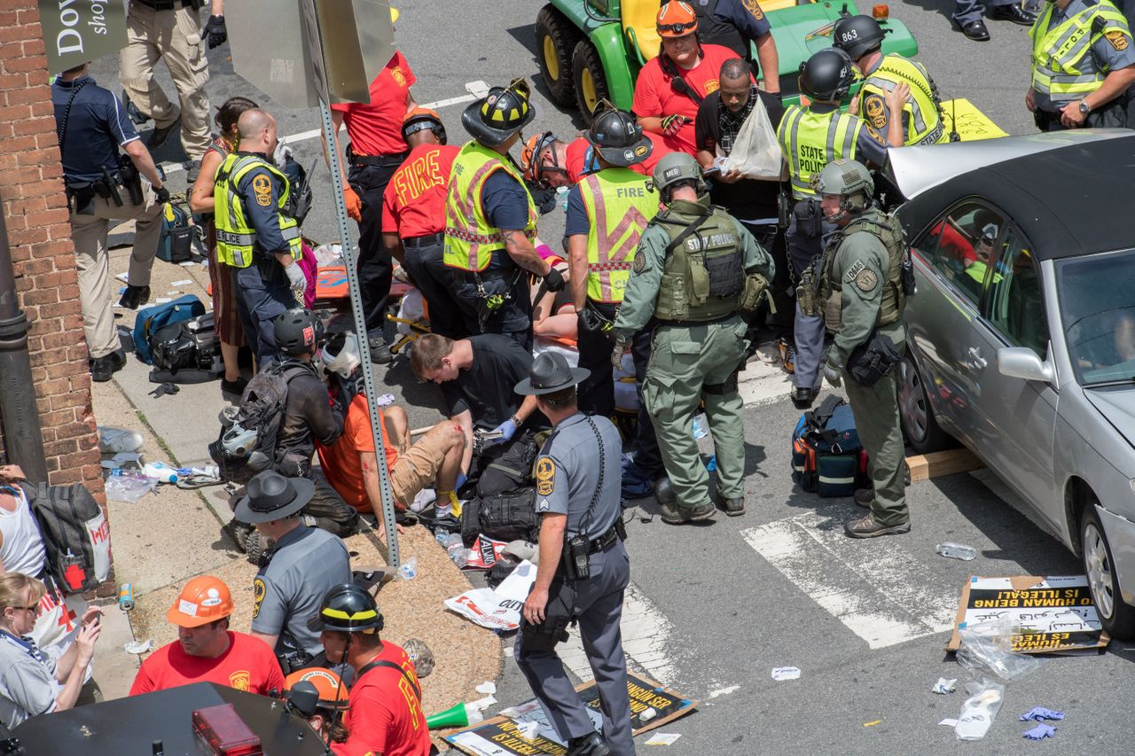 People receive first aid after a car drove into a crowd of protesters in Charlottesville, Virginia.