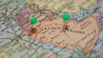Middle east on world map with pushpins in Jordan and Riyadh in Saudi Arabia