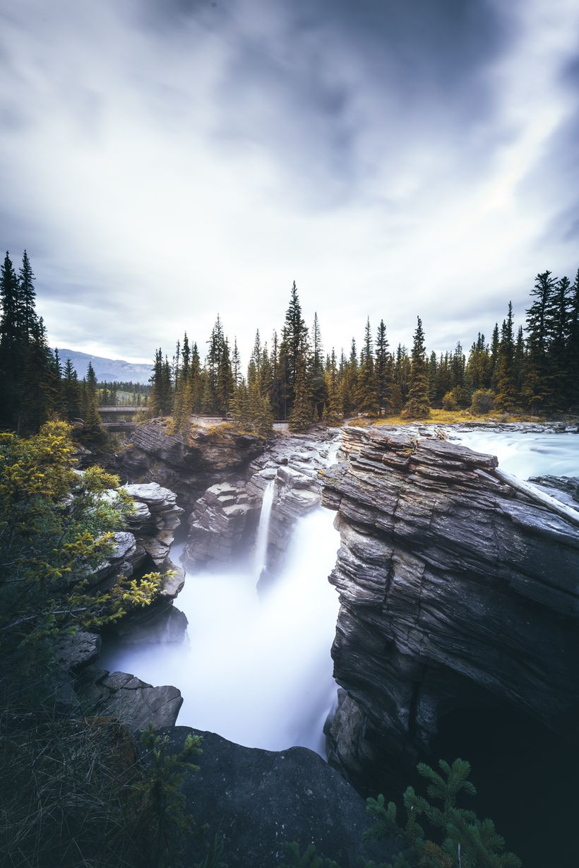Water falling from every direction - that's how it feels at Athabasca Falls. Visiting after a rain storm is even better!