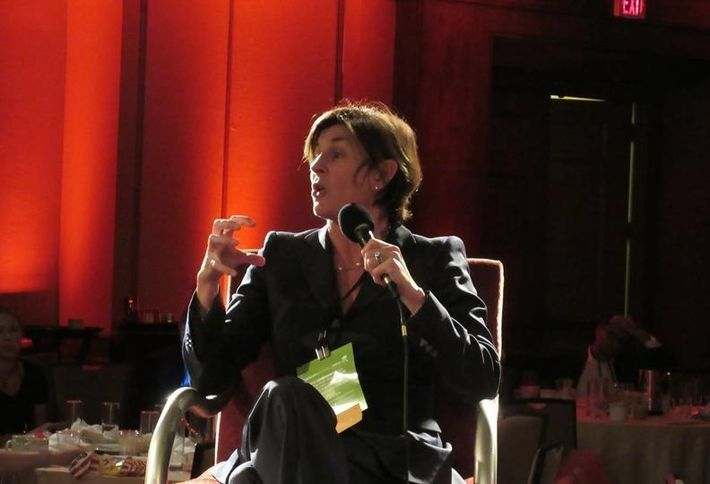 <em>Colliers International Executive Vice President Kitty Wallace, speaking at a Bisnow event</em>