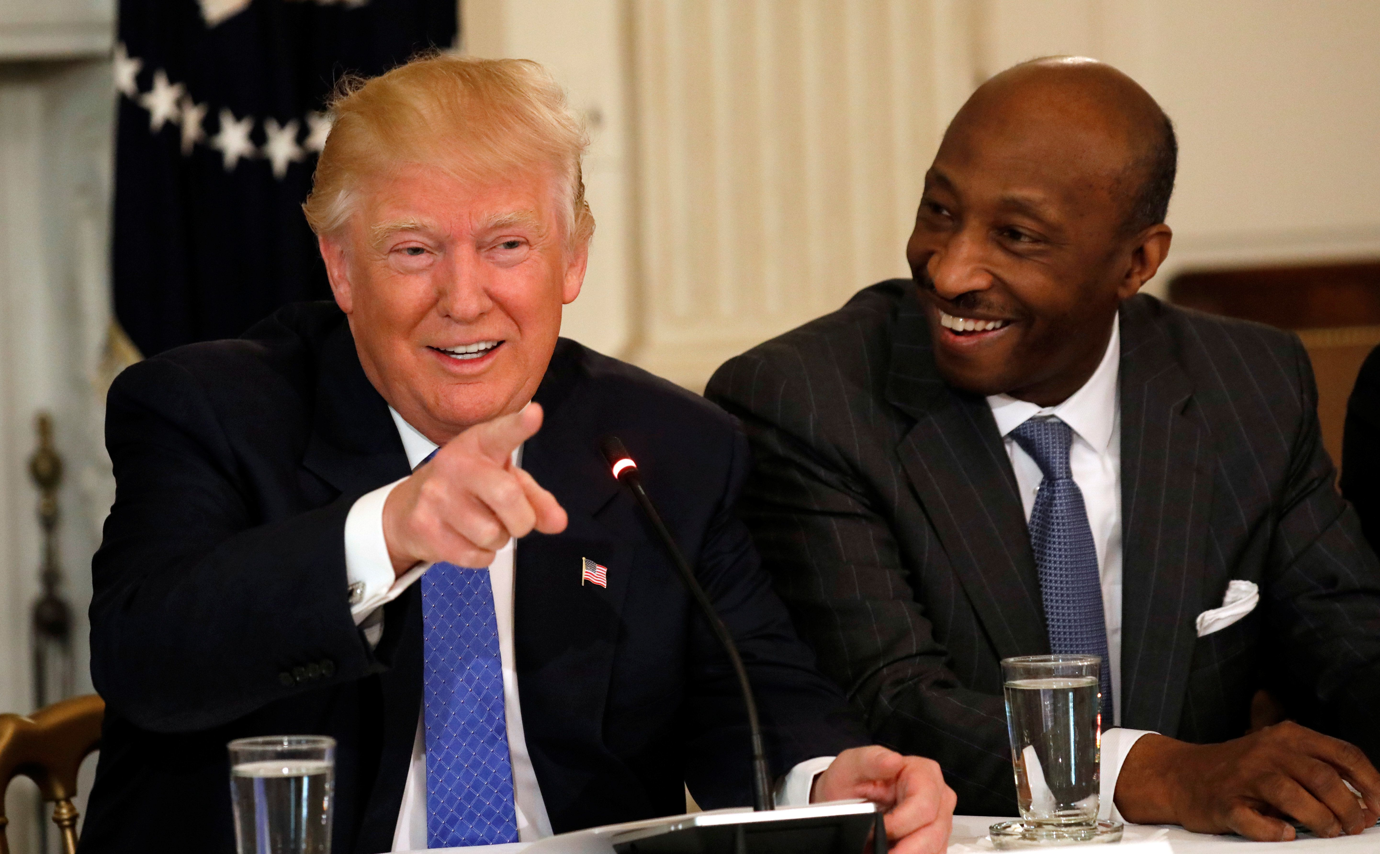 Merck & Co. CEO Ken Frazier (R) listens to U.S. President Donald Trump speak during a meeting with manufacturing CEOs at the White House in Washington, DC, U.S. February 23, 2017. REUTERS/Kevin Lamarque