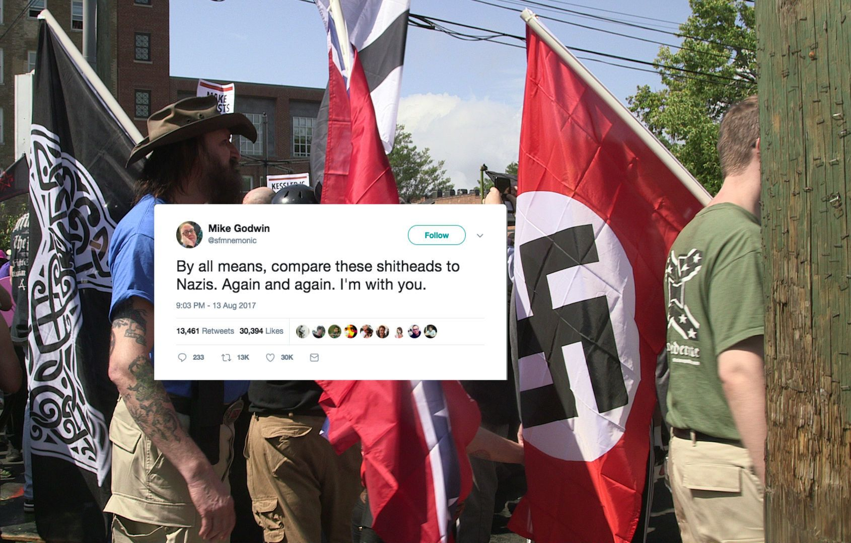 Demonstrators carry confederate and Nazi flags during the Unite the Right free speech rally at Emancipation Park in Charlottesville Virginia USA on August 12 2017 Photo by Emily Molli/NurPhoto via Getty Images