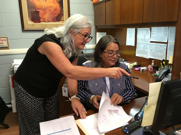 Nancy Bell, left, and Sharon Ortiz-Garcia analyze data on hospitalizations, overdose deaths and infectious diseases related t