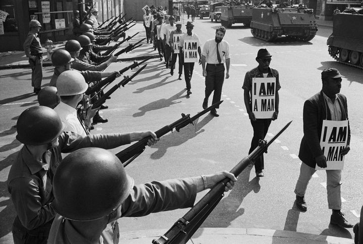 US National Guard troops block off Beale Street as Civil Rights marchers pass by on March 29, 1968