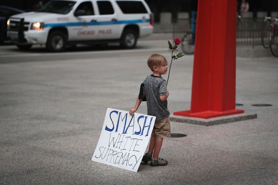 Four-year-old Leo Griffin leaves an Aug. 13 Chicago protest that mourned the victims of the white supremacist rally