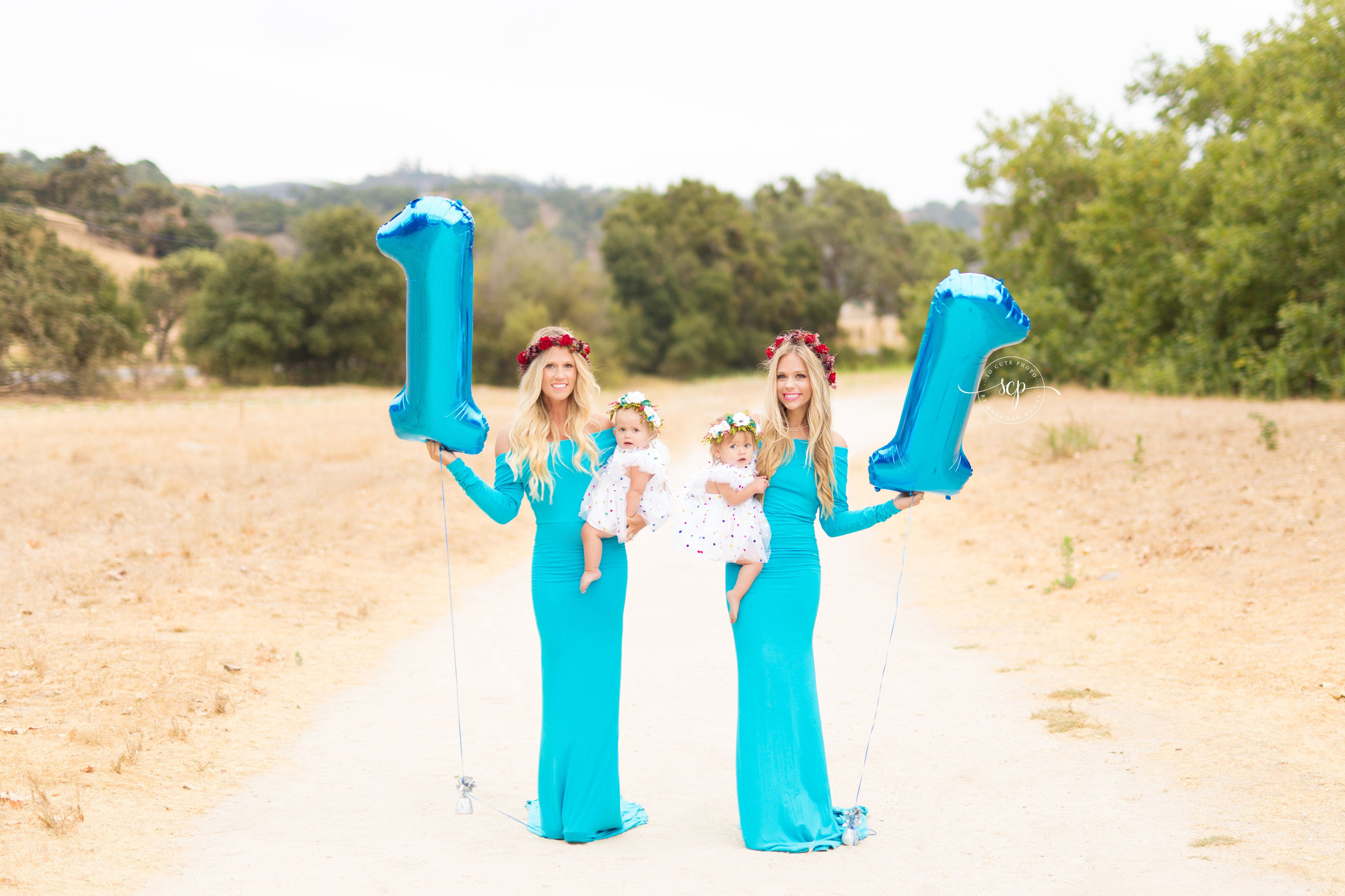 To celebrate the babies' first birthdays, the siblings recreated their maternity photo and included their newest additions.&n