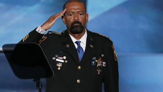 CLEVELAND, OH - JULY 18:  Milwaukee County Sheriff David Clarke salutes the crowd prior to delivering a speech on the first day of the Republican National Convention on July 18, 2016 at the Quicken Loans Arena in Cleveland, Ohio. An estimated 50,000 people are expected in Cleveland, including hundreds of protesters and members of the media. The four-day Republican National Convention kicks off on July 18.  (Photo by Alex Wong/Getty Images)