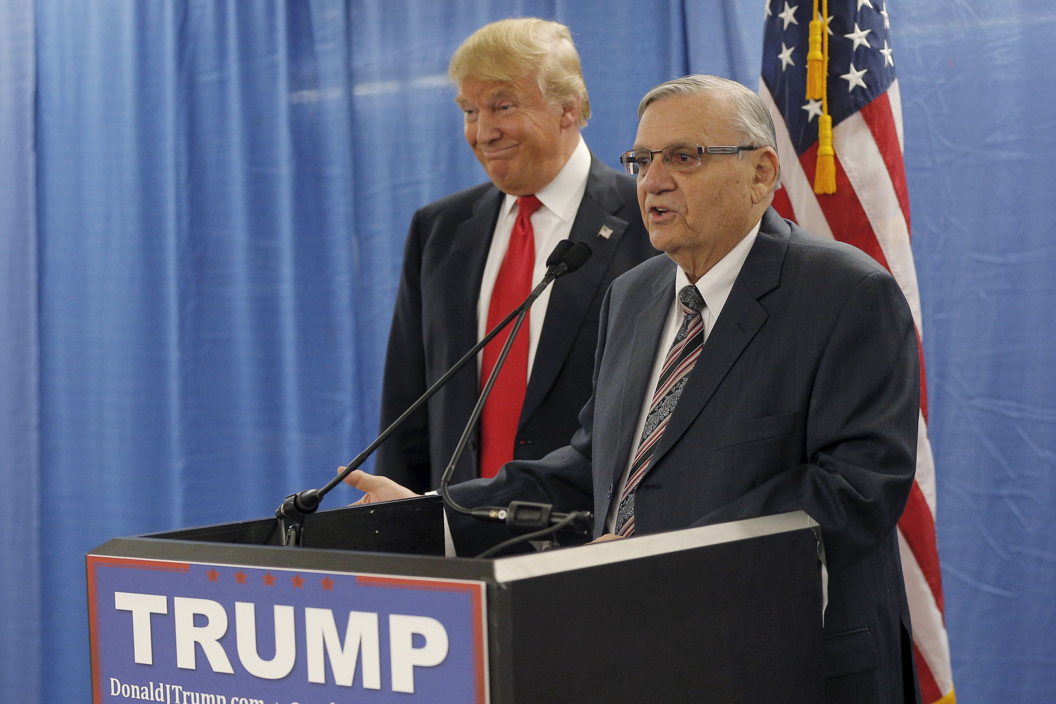 Then-presidential candidateDonald Trump listens to the endorsement of Maricopa County Sheriff Joe Arpaio before a campa