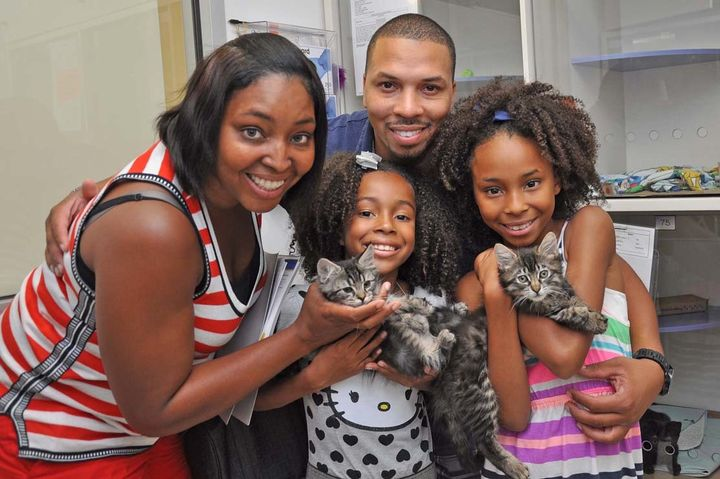 "<em>Family from the New York area with newly adopted pets during ""Clear the Shelters"" 2015.</em>"