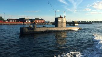 """An unidentified woman stands in the tower of the private submarine """"UC3 Nautilus"""" pictured in Copenhagen Harbor, Denmark August 11, 2017. Picture taken August 11, 2017. Anders Valdsted/Scanpix Denmark via REUTERS   ATTENTION EDITORS - THIS IMAGE WAS PROVIDED BY A THIRD PARTY. DENMARK OUT."""