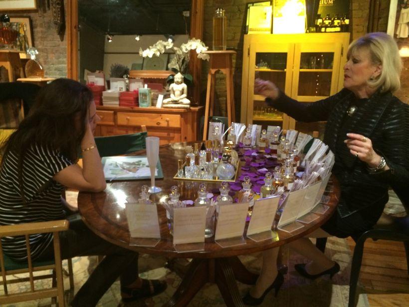 Sue Phillips helps Katie Holmes find her signature scent.