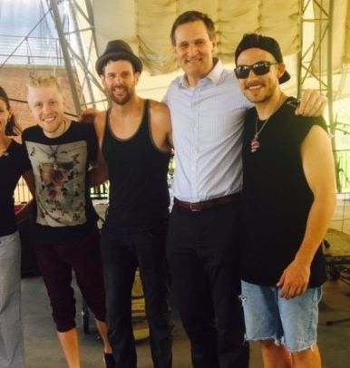Members of the band Crystal Garden are seen with Charlottesville Mayor Michael Signer, second from right, in July.