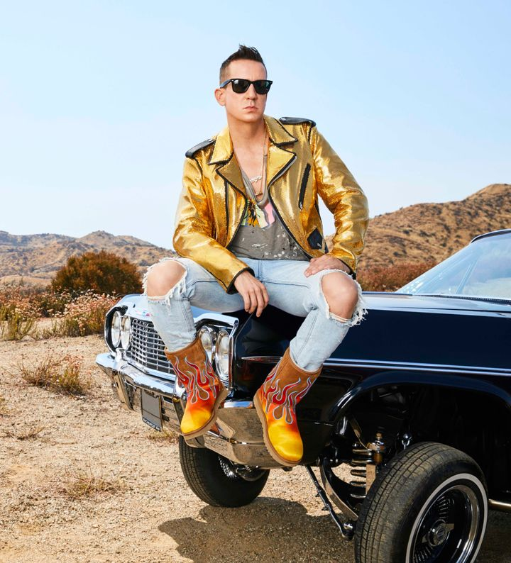 Jeremy Scott models a pair of boots from his collaboration with Ugg.