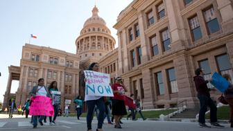Hundreds of pro-immigration marchers arrive at the Texas Capitol and Governor's Mansion in Autin, Texas to protest Gov. Greg Abbott's opposition to immigration reform. (Photo by Robert Daemmrich Photography Inc/Corbis via Getty Images)